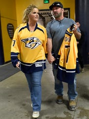 Trisha Yearwood and Garth Brooks enter the stadium before she sang the national anthem at Game 6 of the Western Conference finals at Bridgestone Arena on May 22, 2017.