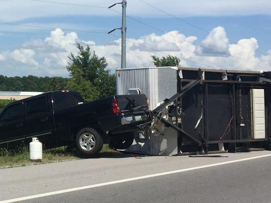 Trailer overturned on I-24