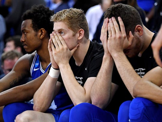 The Duke Blue Devils bench reacts during overtime against