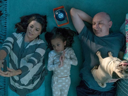 "Eva Longoria's Grace and Rob Corddry's Kurt bond with their introverted adopted daughter after they find a dog at the waterpark in ""Dog Days."""