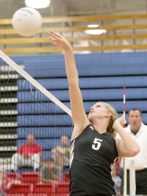 South Side's Shea Dean hits the ball against University School of Jackson on Wednesday.