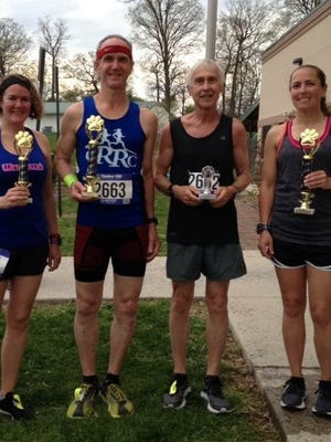 Franklin County runners, from left, Tasia Kenosky, Rodney Small, Ron Slozat and Sarah Boward were all among the top runners at the CVAS 5K-9 in Chambersburg on Friday. Boward won the race in 20:50.