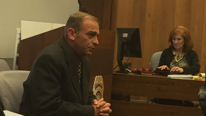 Suspended Indianapolis Metropolitan Police Department officer Johnathan Burger testified in his defense in front of the Civilian Police Merit Board on Tuesday, Nov. 10, 2015.