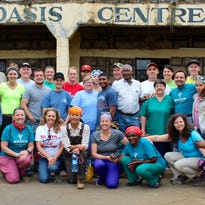 A group of employees from Poet at a school they helped build in Kenya.