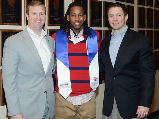 Louisiana Tech athletic director Tommy McClelland, left, senior point guard Speedy Smith, center, and Tech coach Michael White post for a photo last Friday at the stole ceremony.