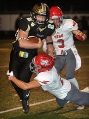 Henrietta quarterback Zack West (24) gets to face Holliday's