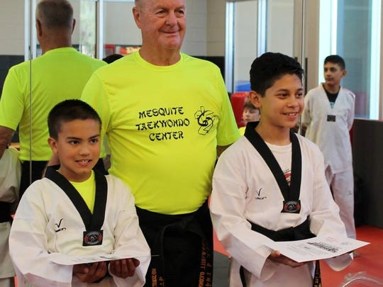"Martin Cordero, Jr. and Mark Davis were recently awarded with black belts by Master ""O"" at the Mesquite Taekwondo Center."