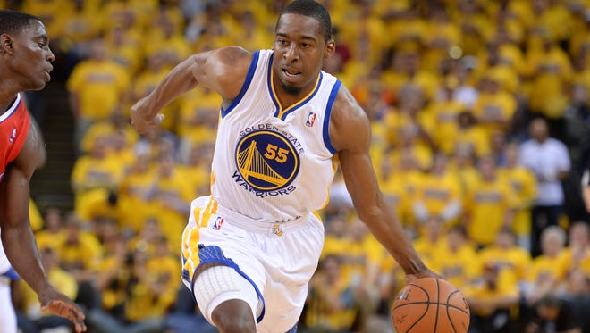 Golden State Warriors guard Jordan Crawford (55) dribbles the basketball during the second quarter in game six of the first round of the 2014 NBA Playoffs against the Los Angeles Clippers at Oracle Arena in May of 2014.
