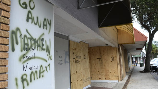 craig bailey/FLORIDA TODAY A sign warns Hurricane Irma to stay away in downtown Melbourne. It worked with Matthew a year ago, at least to an extent. Signs warn away Hurricane Irma in downtown Melbourne, FL. Mandatory Credit: Craig Bailey/FLORIDA TODAY via USA TODAY NETWORK