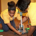 JPMorgan Chase's partnership with higher education includes a $64,000 grant to the University of Louisiana at Monroe School of Education for the enhancement of STEM resources in local schools. Carroll High School's Robopound robotics team gave a demonstration at the presentation of the grant.
