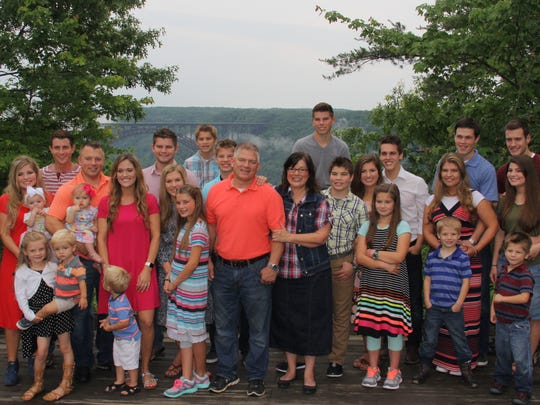 The Bates mega-family of Rocky Top pose for a photo together at Adventures on the Gorge in West Virginia.