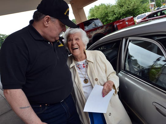 """George """"Butch: Mennie greets Mary Fuhrman, 95 of Dallastown,"""