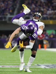 Vikings wide receiver Adam Thielen catches a pass against