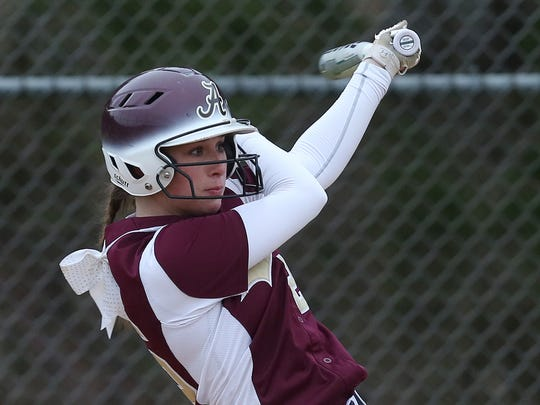 Arlington's Corinne Badger takes a swing during an April 2018 game against Clarkstown North. The star catcher sparked Arlington's run of playoff upsets last week with a grand slam against Clarkstown North.