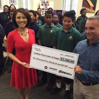 10 News anchor Dion Lim talks to students at Academy Prep on Wednesday.