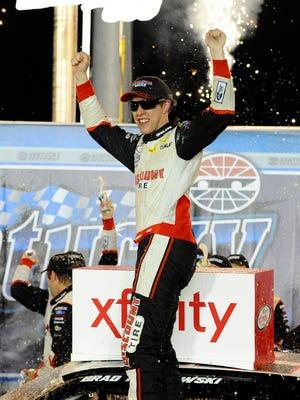 Brad Keselowski celebrates his Xfinity win at Kentucky.