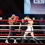 """Andy Karl, right, and Terence Archie perform a number from """"Rocky,"""" during a rehearsal for the Tony Awards at Radio City Music Hall on Friday, June 6, 2014, in New York. Sunday's Tony Awards telecast will feature the usual black ties, soaring songs and gentle jokes _ and an eye-popping boxing match between Rocky and Apollo Creed in a regulation-size ring on the Radio City Music Hall stage. (AP Photo/Mark Kennedy)"""