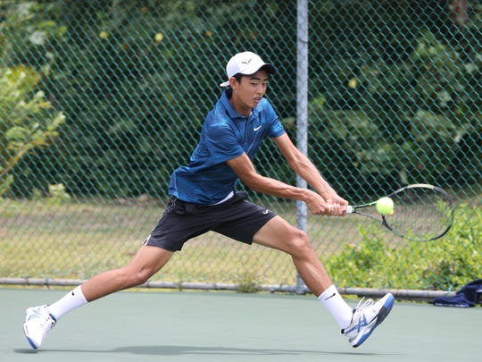 Mason Caldwell is shown in this file photo at the Rick Ninete Tennis Center in Hagåtña.