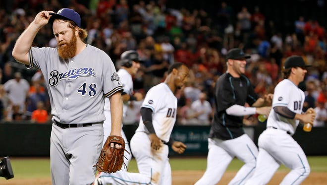 Brewers reliever Blaine Boyer walks off the field after giving up a base-loaded walk to let in the winning run in the 11th inning of a 3-2 loss to the Diamondbacks on Aug. 5 at Chase Field.