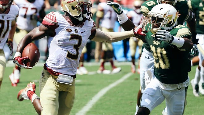 Bobo Wilson stiff arms a South Florida defender during Saturday's 55-35 win.