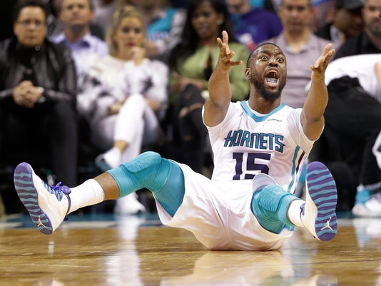 Charlotte Hornets' Kemba Walker (15) argues for a foul during the second half of an NBA basketball game against the Orlando Magic in Charlotte, N.C., Monday, Dec. 4, 2017. (AP Photo/Chuck Burton)