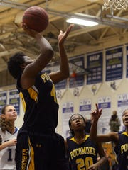 Pocomoke's Dynaisha Christian puts up a shot to get her 1000th point Thursday night at Stephen Decatur in Berlin.