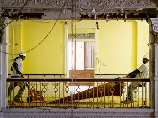 The Kunkel Group employees Tom Dayne (left) and Jerry Walsh remove carpeting on the second floor of the old Hotel McCurdy Wednesday afternoon, Jan. 26, 2016. Renovations are nearing completion.