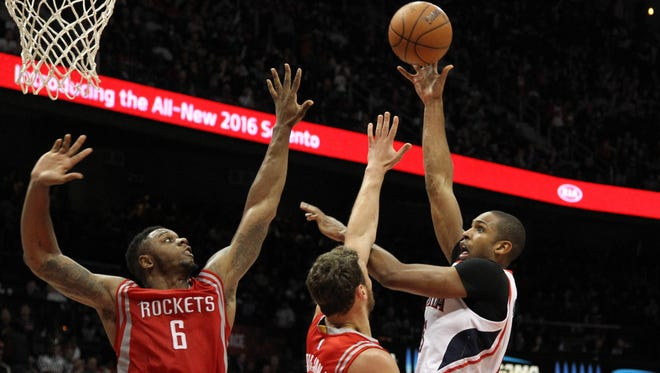 Atlanta Hawks center Al Horford (15) shoots the ball against the Houston Rockets in the third quarter at Philips Arena.