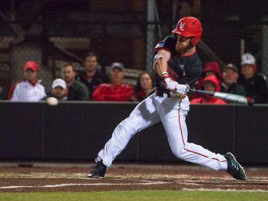 UL's Daniel Lahare (26) swings at an incoming pitch