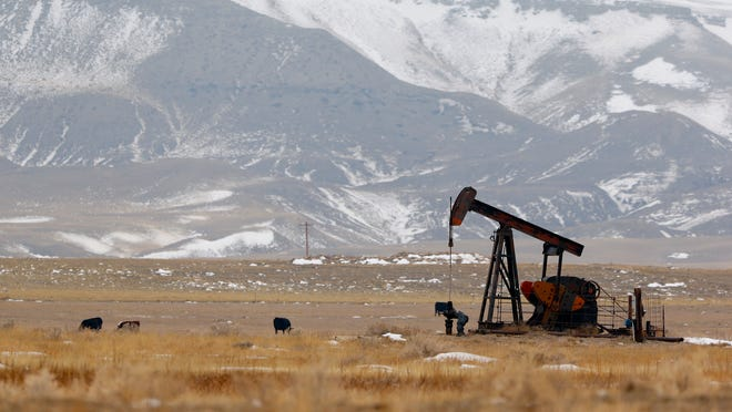 A pump jack pulls crude from an underground reservoir in an oil field in northern Toole County. TRIBUNE PHOTO/LARRY BECKNER