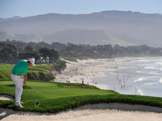 Brandt Snedeker hits out of the rough on the ninth hole during the final round at Pebble Beach Golf Links in Pebble Beach, Calif., on Feb. 15, 2015.