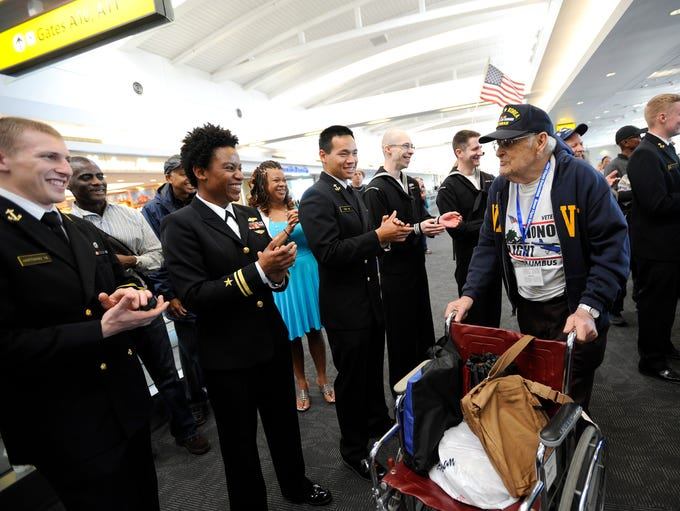 Thurman is greeted by students from the U.S. Naval