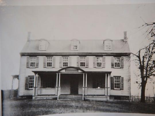 Historic photo of the original Albertson House in Magnolia.