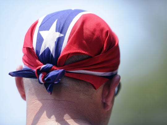 FILE - In this July 9, 2011 file photo, a man wears