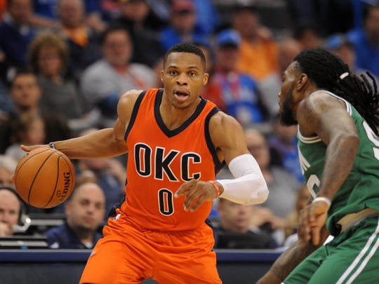 Nov 15, 2015; Oklahoma City, OK, USA; Oklahoma City Thunder guard Russell Westbrook (0) brings the ball up the court against Boston Celtics forward Jae Crowder (99) during the second quarter at Chesapeake Energy Arena. Mandatory Credit: Mark D. Smith-USA TODAY Sports