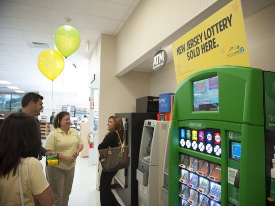 The Super Wawa in Cherry Hill became the second store in the state to have a self-service New Jersey Lottery machine in October 2013. Photo/John Ziomek/Courier-Post
