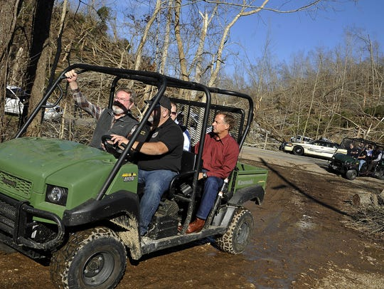 Gov. Bill Haslam takes an ATV to a rural area where
