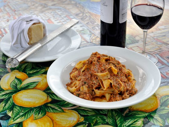 Tagliatelle alla Bolognese  with ground veal, beef and sausage, is a specialty at Cantoro Italian Market's new Trattoria.