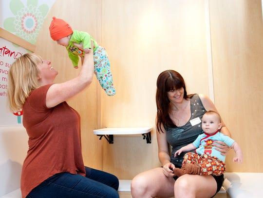 Maggie Lindsay (left) holds four-month-old Cassie alongside