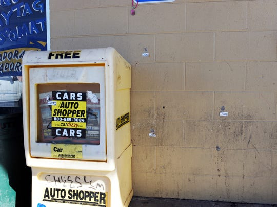 Evidence tags label bullet holes at the scene of Edgar Navarro's killing on on February 3, 2016 in front of the Wash N' Dry Laundromat in Salinas.