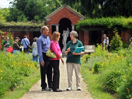 From left, Craig Reason, Jean Moore, both of Boston speak with volunteer Suzanne Gillespie of the City of Poughkeepsie of the Frederick W. Vanderbilt Garden Association, Inc. in this file photo from 2010. The association provides guided tours every third Sunday from May through October.