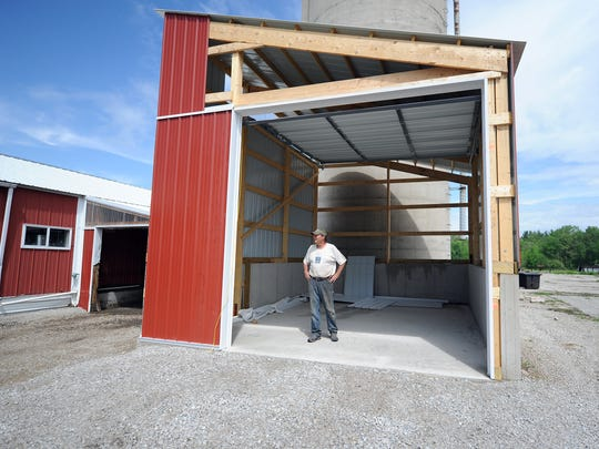 Century Sun Oil founder Dale Johnson stands inside a new building that will expand his company's organic sunflower oil business.