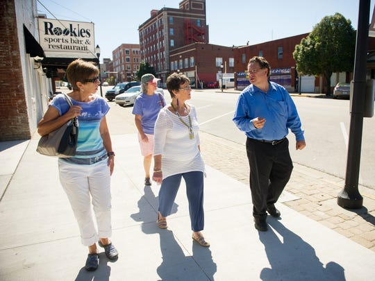 Sharon Evans, (from left), Pam Johnson and Susie Middleton, listen to local historian Frank Nally, all of Henderson, as he explains the history of Second Street during a Depot Community Room historical walking tour of downtown Henderson, Saturday, Sept. 3, 2016. Nally has been leading tours for the last decade.