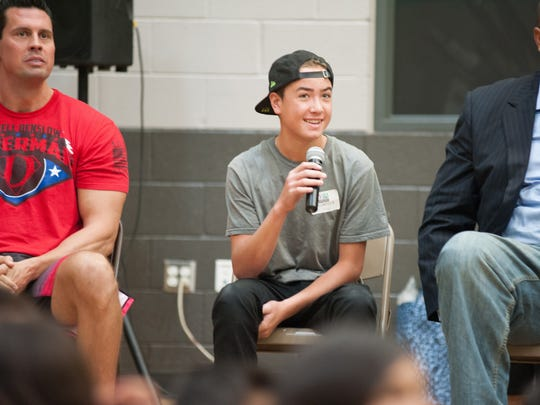 Skateboard champion Trey Wood speaks to participants at the Youth Sports Day event in 2015.