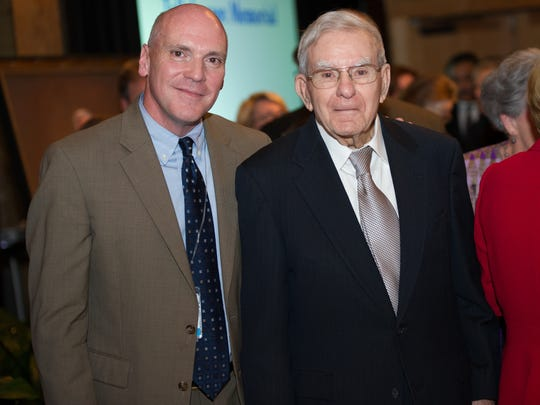 Current TMH administrator Mark O'Bryant stands with retired administrator M.T. Mustian during a ceremony to announce the naming of the hospital's new $250 million surgery and ICU center for Mustian.