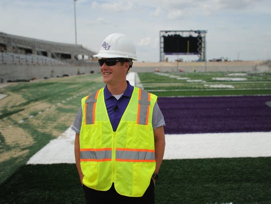 ACU director of athletics Lee De Leon talks to the media almost one year ago while on the field at the school's new on-campus football stadium, which was under construction. The stadium  opened Sept. 16, with the Wildcats defeating Houston Baptist in the team's home opener.