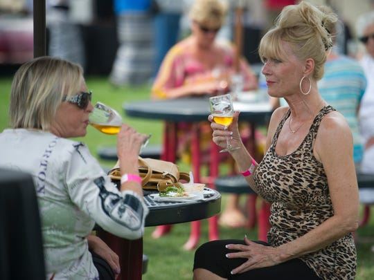 Cindy Borchard (left) and Judi Dransart (right) enjoy a cold beverage while spending the afternoon at a past Conejo Food & Wine Fest.