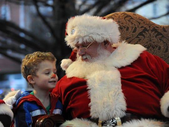 Santa Claus listens to Ronan Bradley, 4, from Lancaster,