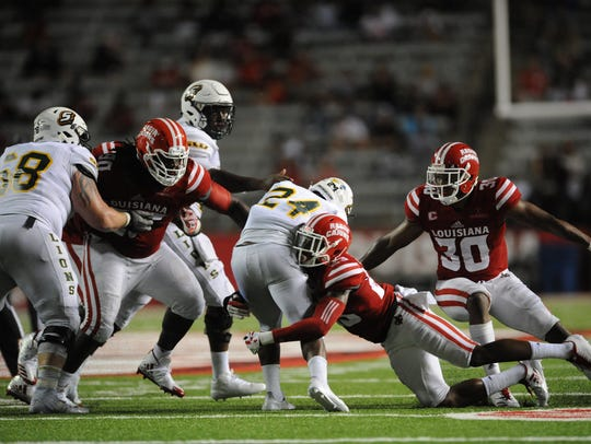Louisiana-Lafayette defensive back Tracy Walker, center,