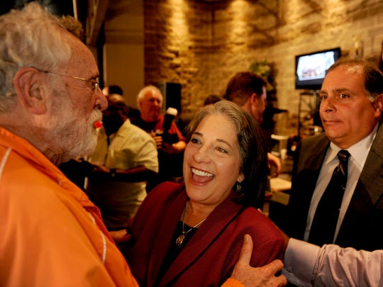 Madeline Rogero hugs Bill Snyder after speaking to her supporters Sep. 27, 2011, in the Foundry about the upcoming runoff for mayor.